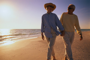 Older Couple Walking Along Beach